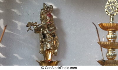 statue of the Hindu god on the altar candle - statue of the...
