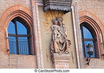 Statue of the Madonna (Niccolo del Arca) on the facade Palazzo C