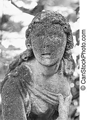 Statue of woman on tomb as a symbol of depression and sorrow