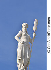 Statue on blue sky background