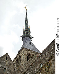 statue on spire of tower abbey mont saint-michel