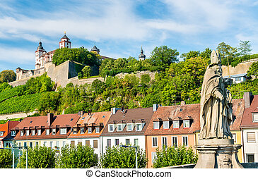 Statue on the Alte Mainbrucke and Marienberg Fortress in Wurzburg, Germany