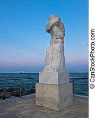 Statue on the Mole in Warnemuende (Germany).