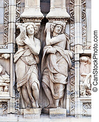 Statue on the wall of Milan cathedral