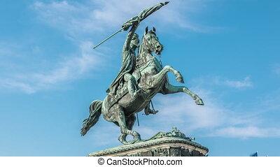 Statue rider Erzherzog Karl ( Archduke Charles) on horseback with flag in hand timelapse. Heldenplatz (Heroes' Square). Vienna (Wien). Austria