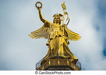 statue - golden statue of Nike the goddess of victory on the...