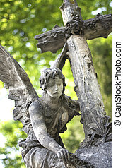 Statue - The statue of a beautiful angel with a Christian...