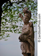 statue with a tree