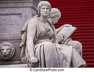 statues at Gendarmenmarkt - two female statues with the...