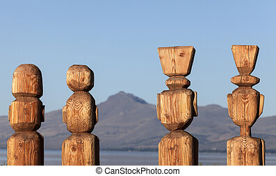 Four statues by Nahuel Huapi Lake in Bariloche, Argentina.