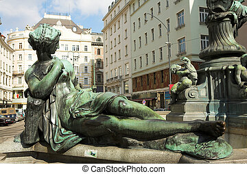 Statues infront of buildings in Vienna