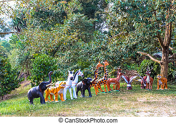 Statues of animals in the forest