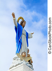 Statues of Holy Women in Roman Catholic Church on sky.