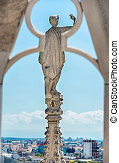 Statues on the roof of famous Milan Cathedral Duomo