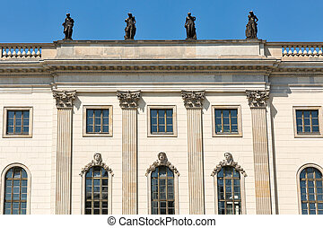 Statues on the roof of university in Berlin, Germany.