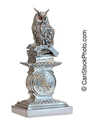 statuette of a bird sitting on a pile of books from the ...