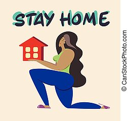 Stay at home. A girl holds a house in her hands.A call to stay home during the pandemic.