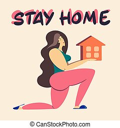 Stay at home. A girl holds a house in her hands.A call to stay home during the pandemic. Quarantine