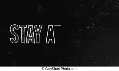 Stay at home concept written on blackboard