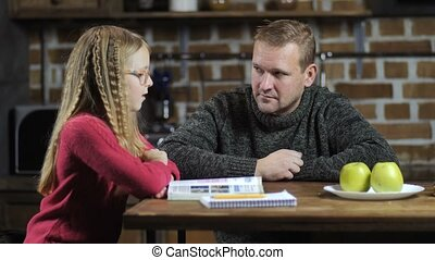 Stay-at-home dad helping daughter with studies