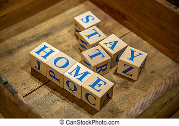 Stay at Home. Wooden cubes with blue letters