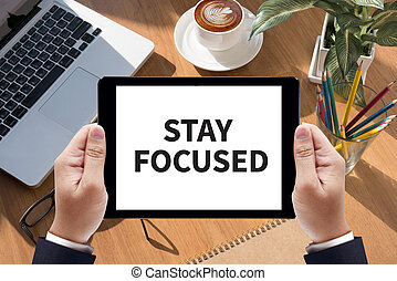 STAY FOCUSED Businessman work on tablet on screen