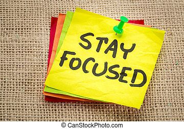 stay focused reminder on a sticky note