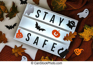 Stay safe. Text in white light box, with a background of ...
