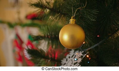 Steadicam shot around the golden bauble hanging on Christmas...