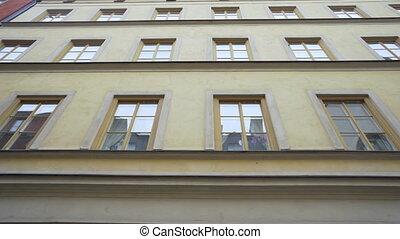 Steadicam shot: modern buildings in old european city. ...