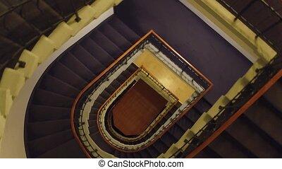 Steadicam shot of generic old building stairwell, top view. 4K video