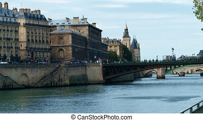 Steadicam walk along the Seine river embankment and old...