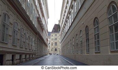 Steadicam walk through narrow pedestrian street in Vienna,...
