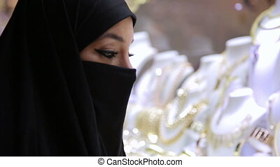 Steadycam - Woman with headscarf shopping at Grand Bazaar, Istanbul, Turkey