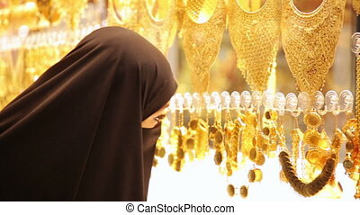 Steadycam - Woman with headscarf shopping at Grand Bazaar,...