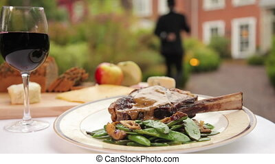 Steak and beans beautifully plated - A scenic shot of cooked...