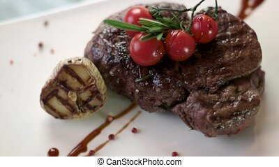 Steak and cherry tomatoes. Herbs and grilled garlic. Juicy...
