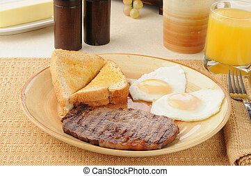 Steak and eggs - A breakfast of grilled rib steak and over ...