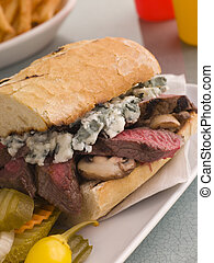 Steak and Roquefort Sandwich with Fries Gherkins and Chillies