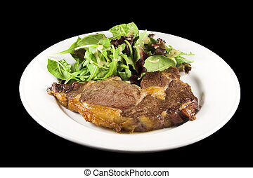Steak and salad - Cooked steak with salad on a white plate