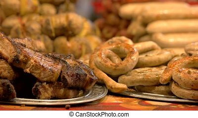 Steak and sausages. Platters with meat. Christmas fair food.