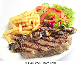 Steak chips and mushrooms - A meal of steak with mushrooms,...