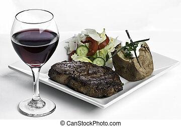 Steak Dinner and Red Wine - Rib-Eye steak dinner with garden...