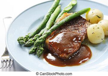 Steak Dinner - Beef steak with peppercorn sauce, baby...