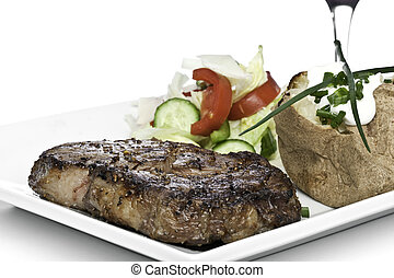 Steak Dinner with salad and potatoe - Rib-Eye steak dinner...