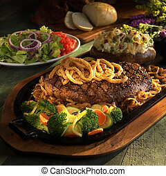 Steak for two - Large steak topped with fried onions with...