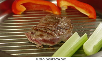 Steak Grilled - Beef steak grilled with vegetables in a...