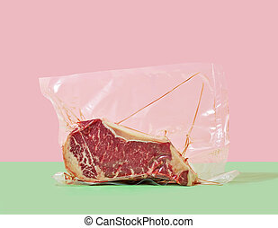 steak in cellophane packaging on a colored background