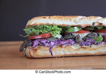 Steak meaty sandwich filled with vegetables Closeup