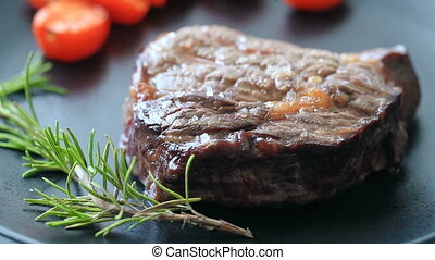 Steak on a dish - Cooking. Prepared steak on a dish with...